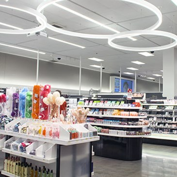 The beauty department with displays of products and gondolas
