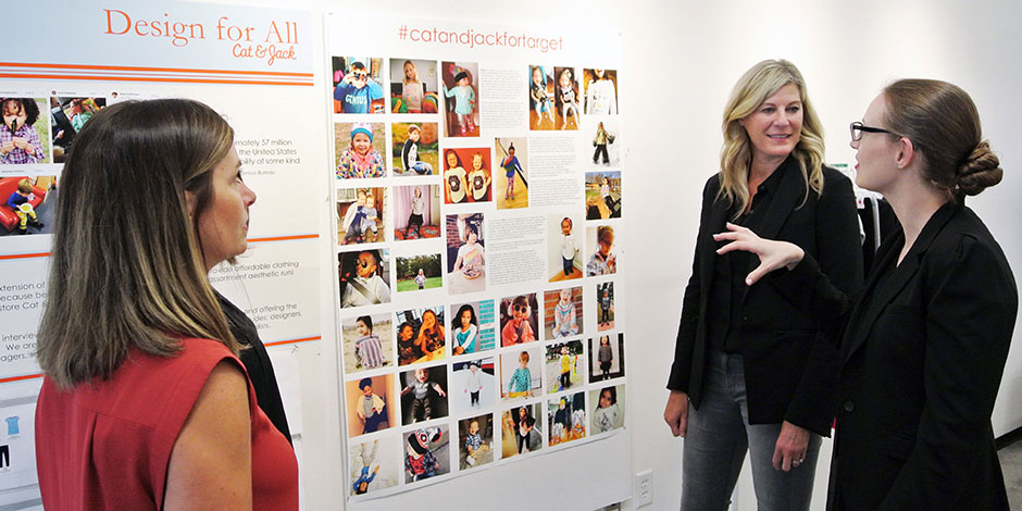 Mari Anderson, Julie Guggemos and Stacey Monsen standing in front of a Cat & Jack design board