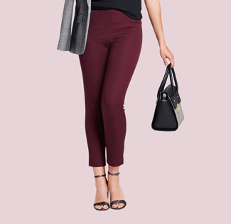 A model wears ankle-length maroon pants