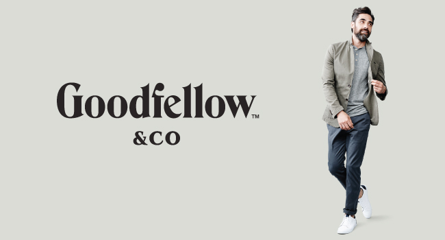 The Goodfellow & Co logo appears next to a man wearing a neutral jacket, t-shirt and pants.