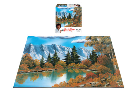 A fall mountain and lake landscape painting in puzzle form
