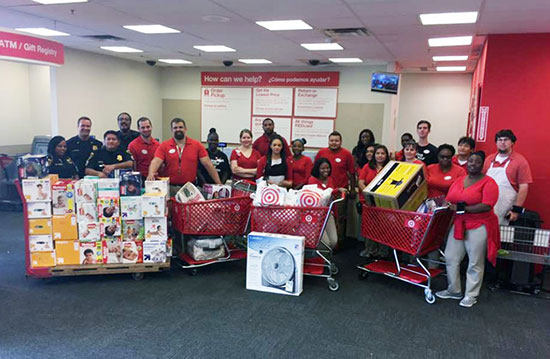 Target team members and police officers stand in the Guest Service area with carts full of donations