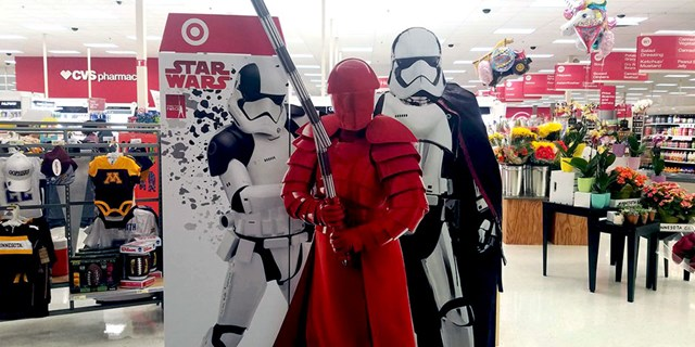 Star Wars characters on a display board at the front of a Target store