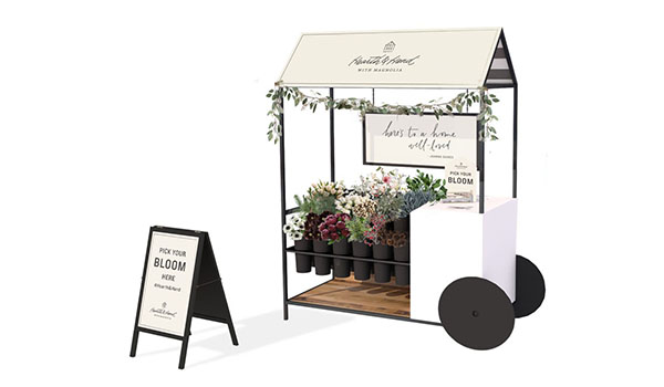 A rendering of the flower cart and sign with flowers inside