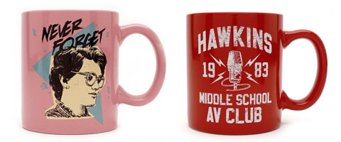 "A pink ""Never Forget"" mug featuring Barb's face and a red ""Hawkins Middle School AV Club"" mug"