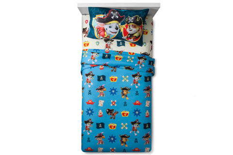 A twin bed made up in PAW Patrol Pirate Pups sheets