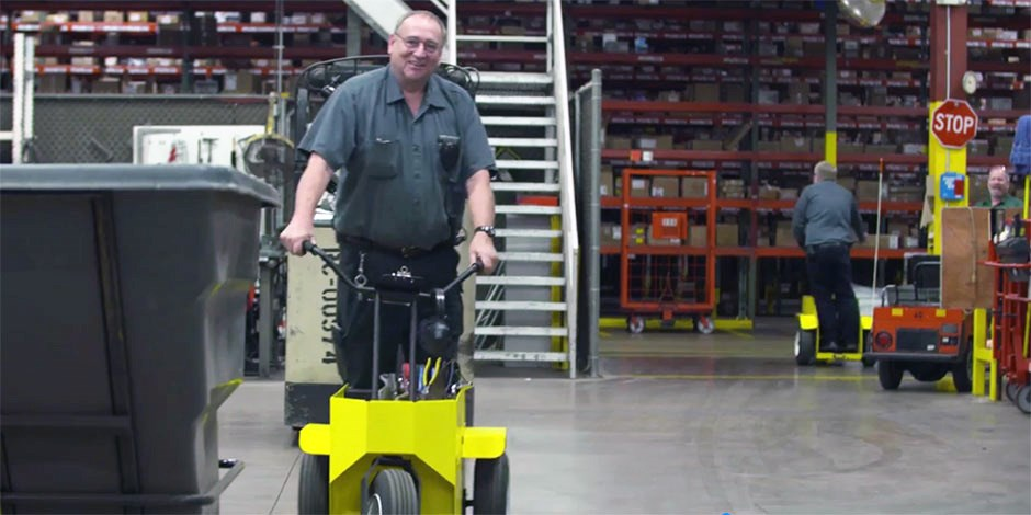 DC mechanic Jim Gerard rides a motorized segway in his DC