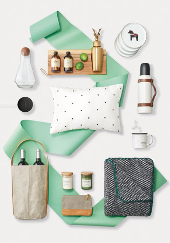A set of products from Target's gifting collection, from mugs and a thermos to a cozy pillow