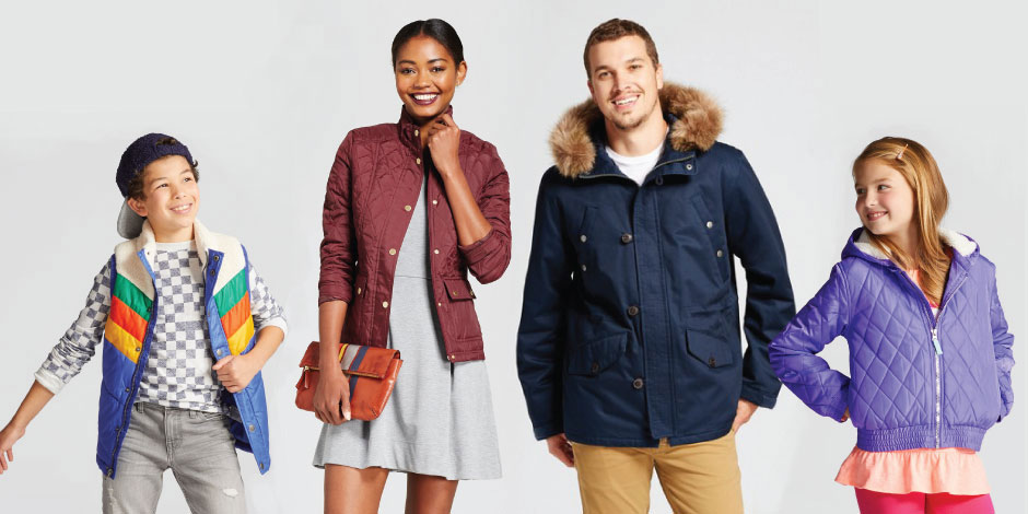 Four family members modeling coats and accessories from Target's collection