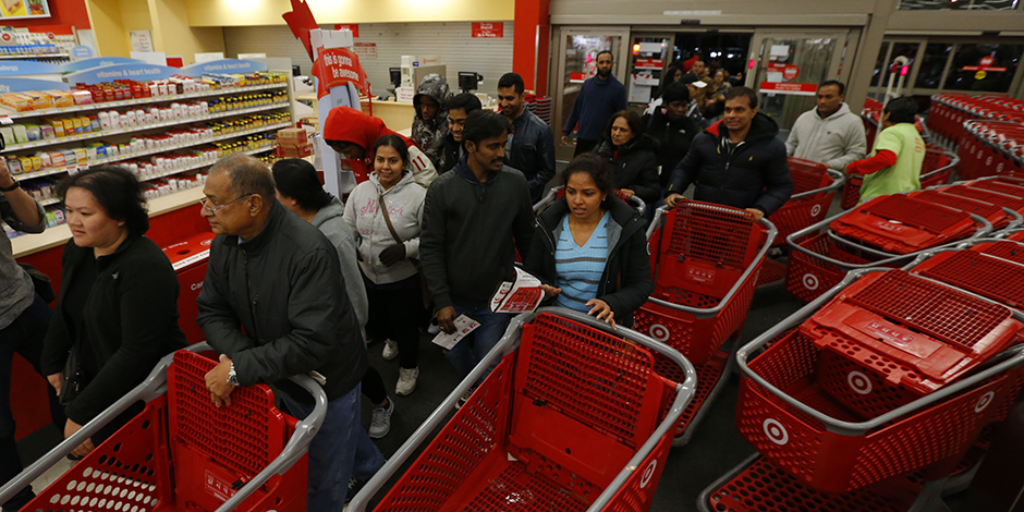 Guests push carts through the entrance of a Target store on Black Friday