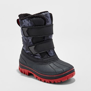 Navy winter boots with red soles and two straps