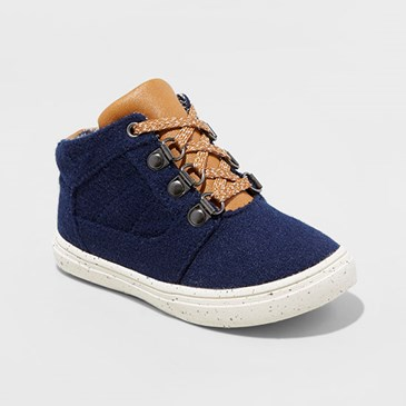 Navy sneakers with tan laces and tongue