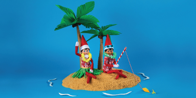 Two elves in Hawaiian attire relax on an island