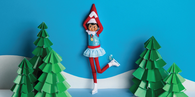 An elf in skating attire poses
