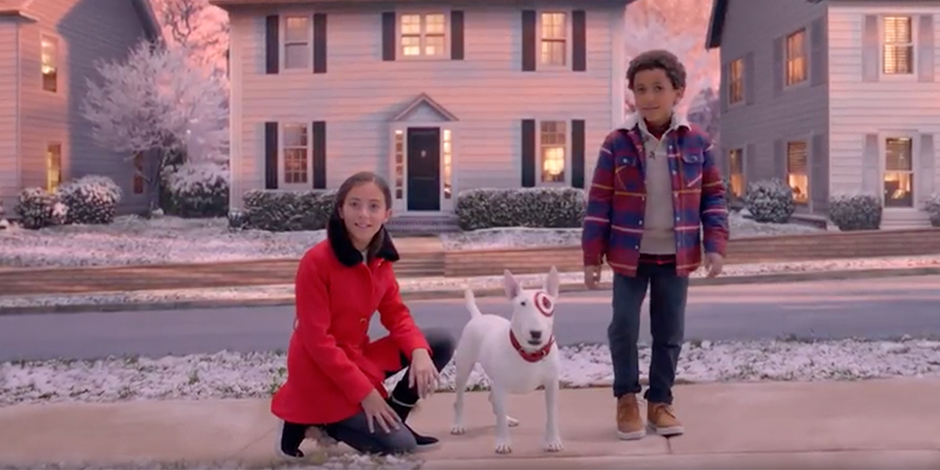 A young girl and boy, along with Bullseye the dog, look on in wonder