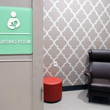 A nursing room with chair and table