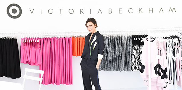 Victoria Beckham poses in front of an assortment of her exclusive line for Target