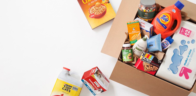 A shipping box spills over with products, from Tide to Cheerios and more