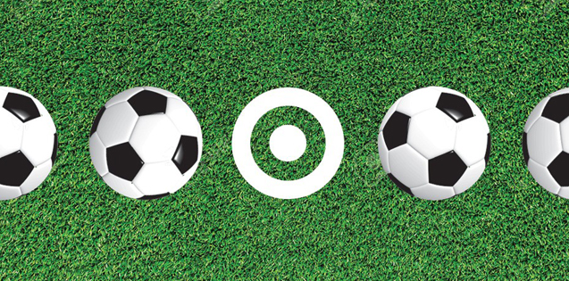 Soccer balls and a white bullseye logo against a grassy background