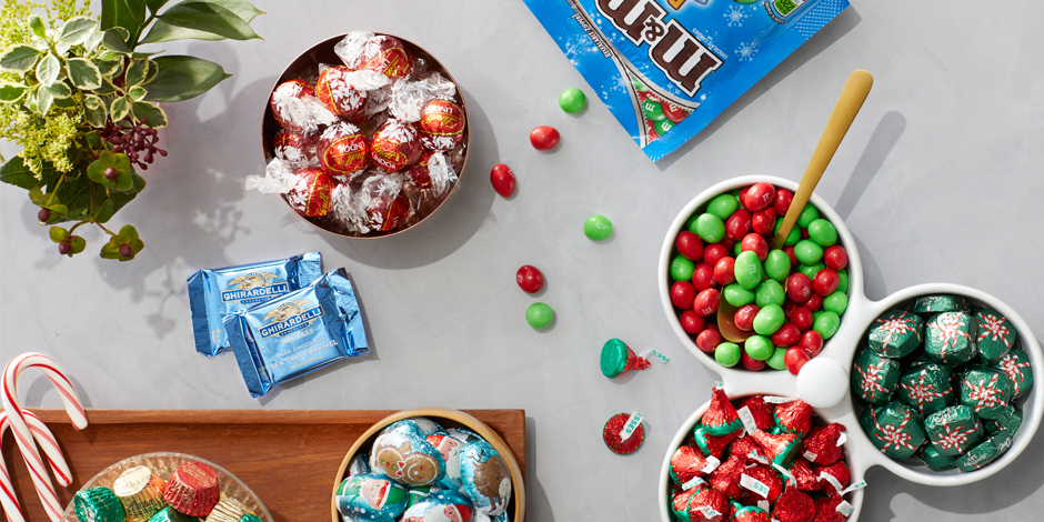 A variety of Target-exclusive holiday candy in candy dishes and on serving trays