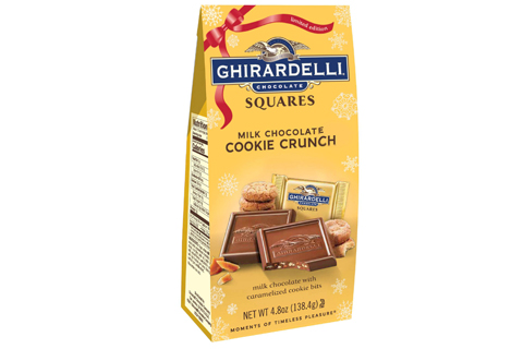 A yellow package of Ghirardelli milk chocolate cookie crunch squares