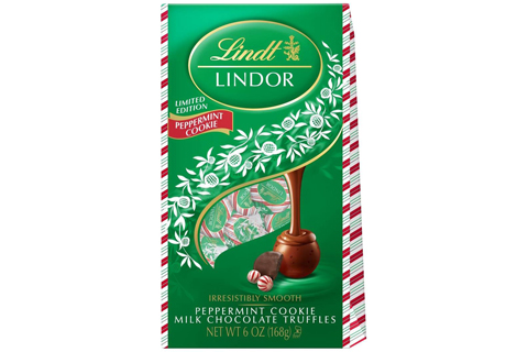 A green and candy-cane-striped package of Lindt Lidor chocolates