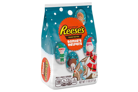 A package of Reese's Santa's Helpers, including a snowy scene and chocolate characters