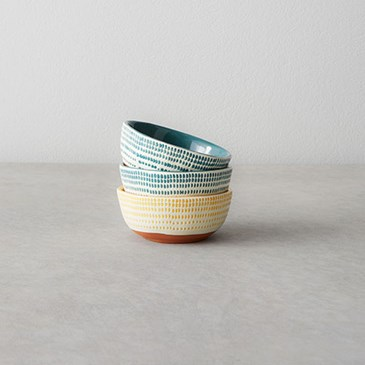 Yellow and blue bowls with cream and terracotta bottoms