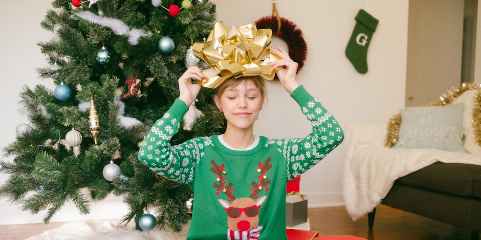 Grace VanderWaal holding up a wrapped Target gift