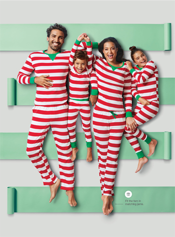 A family wears matching red and white striped pajamas