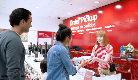 Guests picks up an order at Target's Order Pickup counter