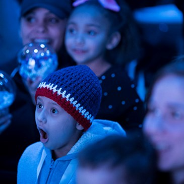 Kids watch the ballet with expressions of wonder and excitement