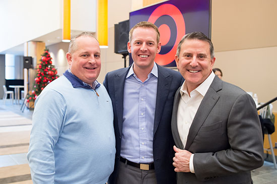 Bill Smith stands with John Mulligan and Brian Cornell in Target Hall
