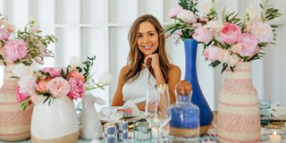 Camille Styles sitting at a spring styled table