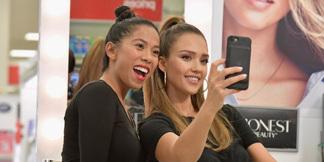 Jessica Alba taking a selfie with a Target guest after an Honest Beauty makeover