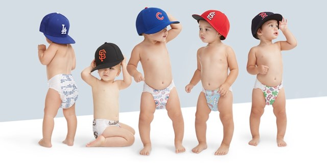 Babies wearing the different Honest Company MLB diaper designs