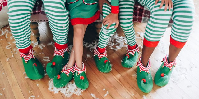 Shay Jiles and her family wearing the Elf Family Pajamas collection