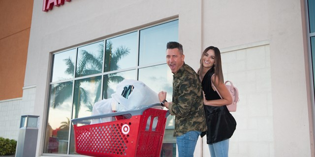 Karla and Jorge outside a Target store with a red Target shopping cart