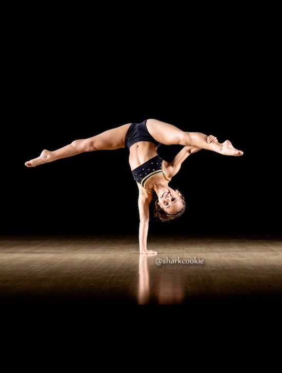 Asia Monet Ray doing a one-hand stand