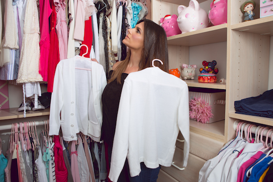 Barbara sorting through her daughters' closet