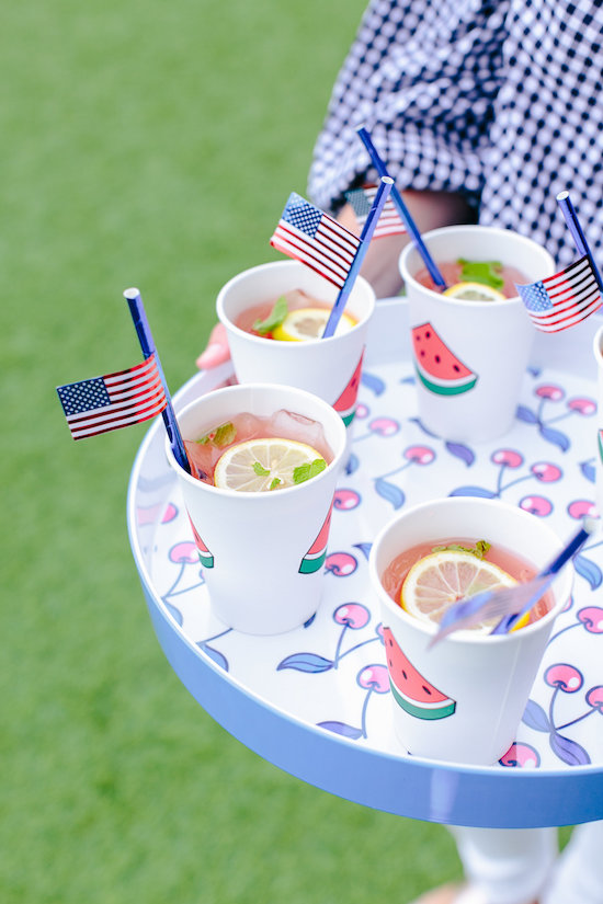 Watermelon cups with lemonade and American flag straws