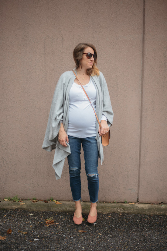 Caitlin Kruse wearing Isabel Maternity jeans, a white t-shirt and grey sweater