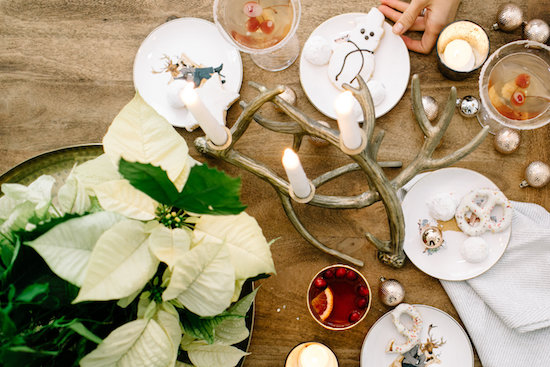 Overhead of reindeer cocktail plates and an antler candle centerpiece