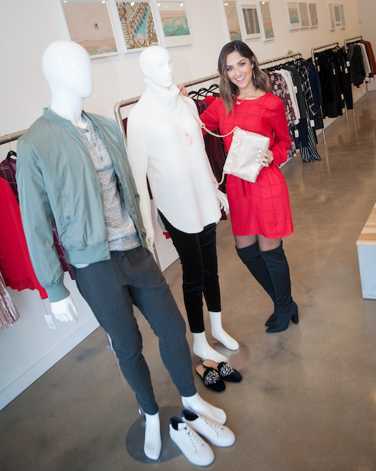 Karla styling two mannequins in comfortable chic holiday looks