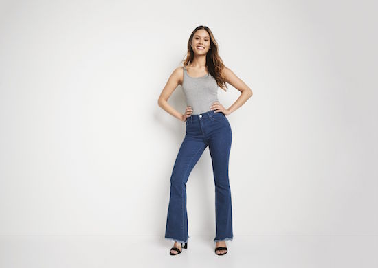 Woman wearing High Rise Flare Jeans in Fargo Wash