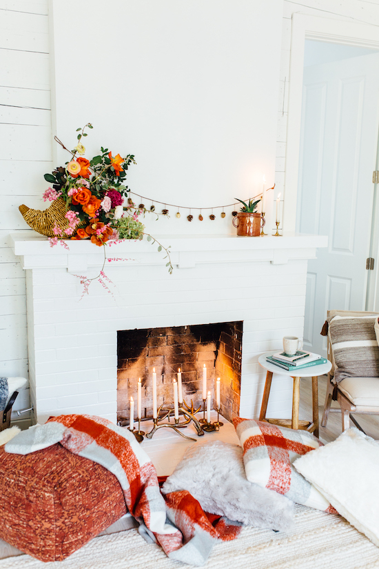 Cozy pillows and throws arranged in front of the fireplace
