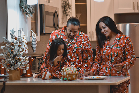 Winston and Rosanna Javier and family wearing the Nite Nite Munki Munki Santa Family Pajama Collection