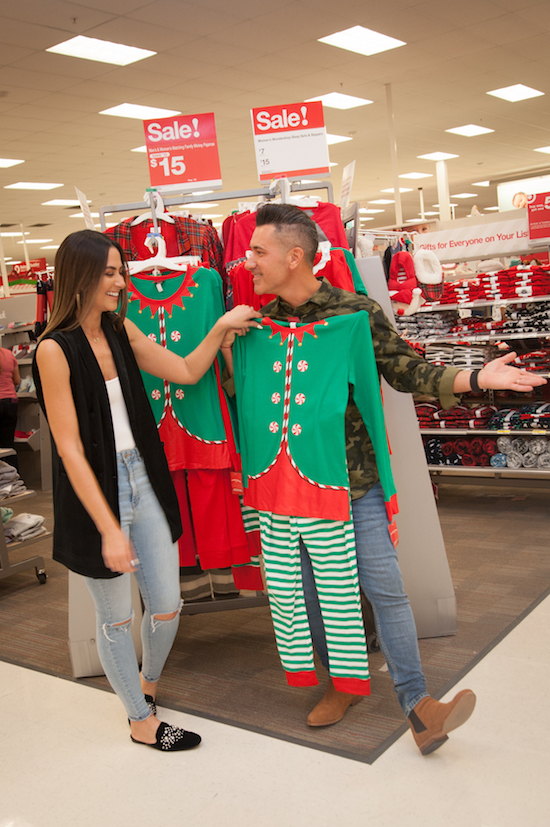 Jorge and Karla in Target looking at matching family pajamas