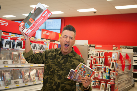 Jorge Bernal holding up Nintendo Switch boxes in Target