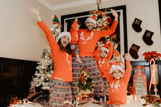 Inger Mendoza and her family wearing Reindeer Fair Isle matching pajamas